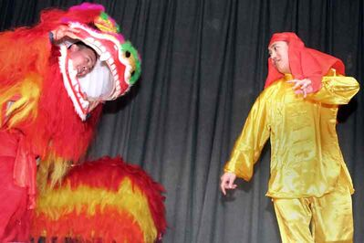 Lion dancing performers kick off the Chinese New Year festivities, hosted by the Brandon University Chinese Students and Scholars' Association, at Knox United Church on Saturday evening.