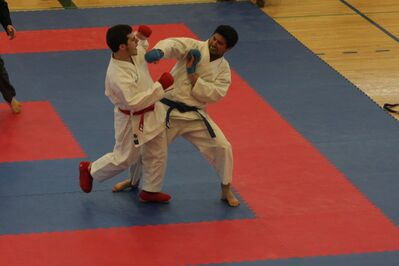 Brandon's Benjamin Thompson (right) delivers a punch to Winnipeg's Nicolas Gosslin in their senior men's black belt kumite semifinal at the provincial karate championships in Shilo on April 27.