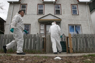 Police officers at a rooming house on Lorne Avenue in Point Douglas where the body of Myrna Letandre was discovered in May 2013.