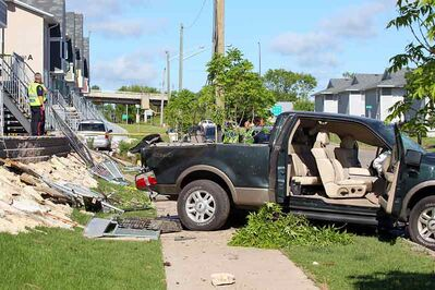 Debris litters the ground after a pickup struck a Manitoba Housing development on Stickney Avenue in June 2012. Brett Natrasony faced several charges in the crash, including dangerous driving causing bodily harm and impaired driving causing bodily harm in relation to an 18-year-old passenger.
