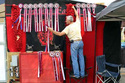 Steve Wakeman of Imagine Farms in Kansas hangs the National Champion Stock Hunter Halter Mare class award alongside other awards won by Imagine Farms during the Canadian National Arabian & Half-Arabian Championship Horse Show at the Keystone Centre on    Saturday.