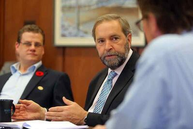 Federal NDP Leader Thomas Mulcair addresses members of the Brandon Sun editorial board during his first stop in the city.