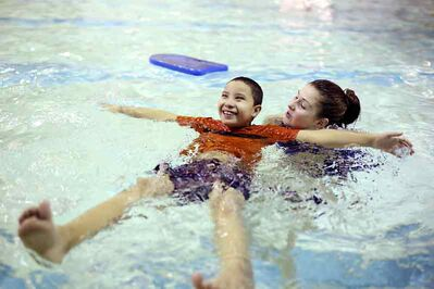 Grade 5 student Dixon Soto Santos gets some help from lifeguard/instructor Jasmine Nicholson while learning how to float on his back at the Sportsplex.