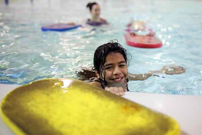 École New Era Grade 5 student Mariela Rodriguez Salgado smiles while taking part in a swimming lesson at the Sportsplex on Tuesday during a free 12-week swimming program for approximately 90 New Era students organized and funded through the Brandon Teachers Association.