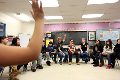 """Aqua, fourth from right, a leadership and aboriginal program facilitator with Free The Children, leads a workshop for 25 students from Meadows School during the charity's """"Power of Stories"""" speaking tour stop at the school on Wednesday."""