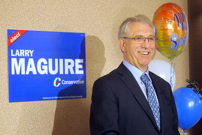 Conservative Larry Maguire smiles for the camera and his supporters at the Victoria Inn after winning the Brandon-Souris federal byelection on Nov. 25. Maguire will be sworn in as a member of Parliament today.