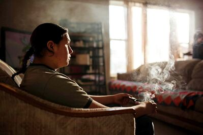 Stephen Bunn, 17, holds a pot with burning sage used for traditional smudging in his home in Brandon.