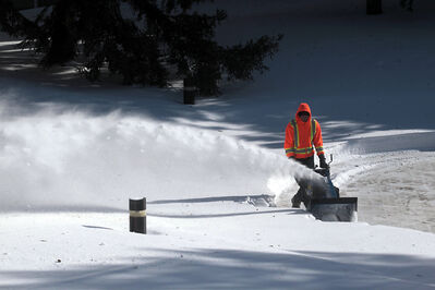 A maintenance worker clears the snow from the circular courtyard outside the School of Music on the Brandon University campus earlier this month. Snowblowers and snow shovels will have to be brought out again after a storm expected this afternoon.