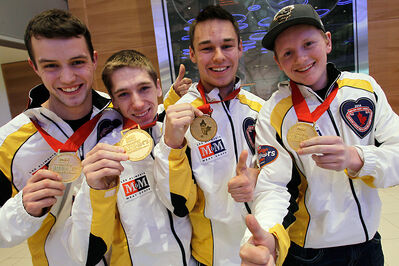 The Manitoba team of (L-R) Brendan Wilson, Lucas Van Den Bosch, Kyle Kurz and Carberry's Braden Calvert show off their medals after arriving back in Winnipeg from the Canadian junior championships last month.
