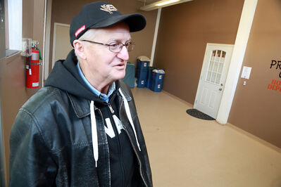 In this December photo, Jake Hamm, a board member with the Helping Hands soup kitchen, looks over the newest location of the city's emergency homeless shelter.