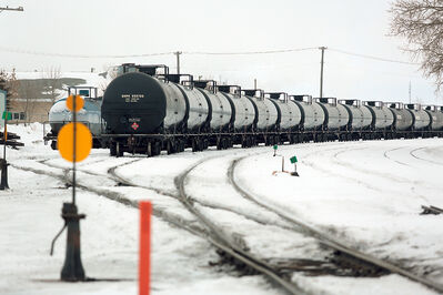 A long line of tanker cars, many of them older DOT-111 cars, sit in the CN Rail yard east of First Street near the Brandon Regional Health Centre and housing on Wednesday. The DOT-111 cars pose a big risk, CN spokesman Mark Hallman says.