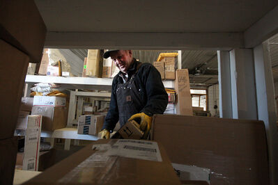 Jay Vanorny and his wife Lola of Dunseith, N.D., have built a booming business by receiving packages for Canadians looking to save on international shipping.