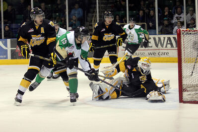 Prince Albert Raiders forward Calder Brooks slides the puck under Brandon Wheat Kings goaltender Jordan Papirny's arm to put his team up 2-1 late in the third period in Prince Albert on Saturday night.