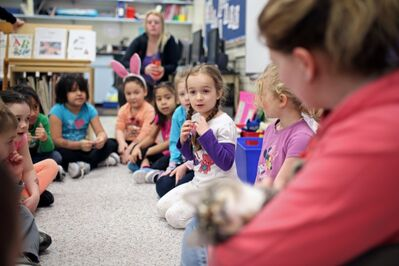 Natalya Corbey (centre) asks a question during show and tell involving classmate Nathan Wishart's cat Spiderman in Carole McCurry's full-day kindergarten class at George Fitton School. Wishart's mom Cat Balfour holds the cat.
