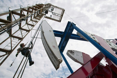 In this July 26, 2011, photo, a worker hangs from an oil derrick outside of Williston, N.D. Brandon Mayor Shari Decter Hirst writes that the Wheat City is ideally suited to benefit from the boom in the Bakken oil reserves, especially when the drilling moves further east. (File)
