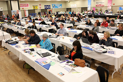 Delegates listen as CUPE Manitoba president Kelly Moist speaks during the CUPE Manitoba annual convention at the Keystone Centre on Tuesday.