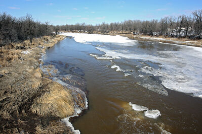 Ice on the Assiniboine River is seen beginning to break up at the Highway 340 bridge southeast of Brandon Monday.