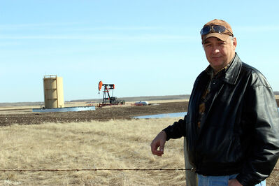 Birtle Reeve Roger Wilson stands in front of an oil well in the Birdtail Field from which the RM receives royalties — thanks to a decades-old  decision to retain mineral rights on farms repossessed during the Great Depression when they were put back up for sale.
