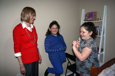 Mayor Shari Decter Hirst gets a tour of the third STEPP home in Brandon from Jayda Desjarlais (centre) and her sister Rheanna on Monday.