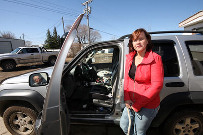 Leanne Hermary Fortune stands beside her SUV, from which her beloved dog, LJ went missing. Hermary Fortune was confined to a wheelchair due to illness, and the poodle was her inspiration to walk again.