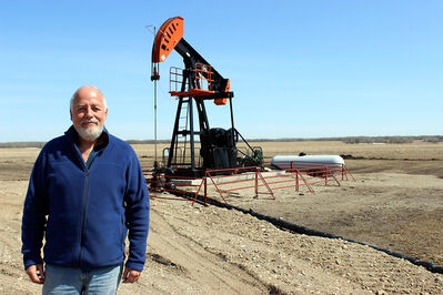 George Wady stands in front of the oil well in which he shares mineral rights, in the new Birdtail Field near Birtle. Wady owns 25 per cent of the rights, a cousin owns another 25 per cent, and a woman in California he has never heard of owns the rest — the legacy of a land speculator from the United States who bought up rights from cash-strapped Manitoba farmers in the 1940s.
