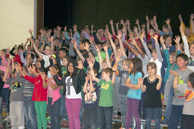 Meadows School music teacher Christine Penner leads nearly 80 Grade 3 and 4 students through a singing performance for Music Monday's 10th anniversary. Meadows was one of five registered Brandon School Division schools participating in the annual event.