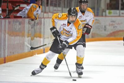 Brandon Wheat Kings prospect Linden McCorrister keeps control of the puck during the Wheaties' prospects camp intrasquad game at Westman Place on Sunday morning.
