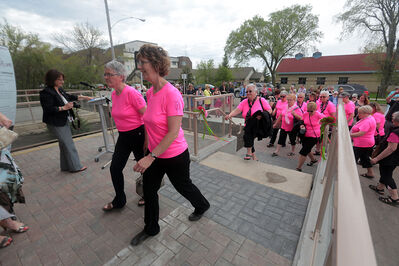 Members of the Westman Waves of Hope dragon boat team, all cancer survivors, were the first visitors to tour the newly opened Murray House on Frederick Street on Tuesday.