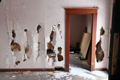 Smashed walls are visible in one of the homes at the Criddle-Vane Homestead south of CFB Shilo in 2012.