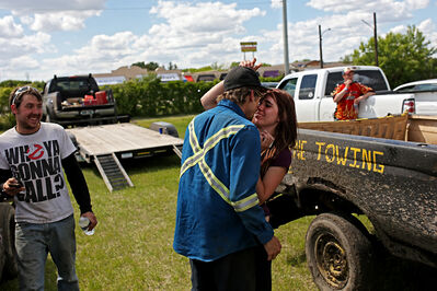 Jarret Redden of Deloraine goes in for a kiss from his girlfriend Sierra Fisher after winning the Truck Class event during the Manitoba Summer Fair Demolition Derby on the Keystone Centre southwest grounds on Sunday afternoon.