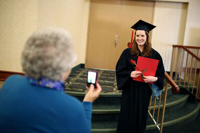 Pharmacy technician graduate Stephanie Morris has her photo taken by her grandmother Betty Morris after her Robertson College graduation ceremony at the Victoria Inn on Friday.