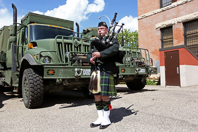 Master Cpl. Jean-Paul Reil plays the bagpipes during a barbecue at the Brandon Armoury following the Defenders Motorcycle Club's third annual Memorial Motorcycle Ride on Saturday.