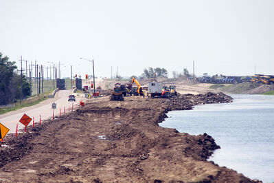 Waters encroach on the construction of Hartney's new bridge Friday. The structure is scheduled to be completed next year.