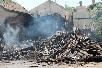 The remains of House Restaurant continue to smoulder after being demolished on Sunday.