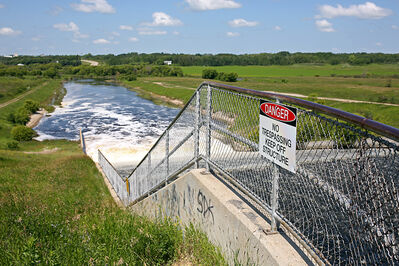 Water pours down the spillway from the Rivers Reservoir into the Little Saskatchewan River just southeast of Rivers on Monday. A Rivers woman is dead and a Brandon man is missing and presumed dead after an ATV accident at the spillway on Saturday.