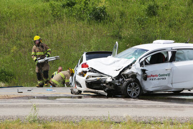Emergency crews work at a two-vehicle collision on Highway 10 approximately 15 kilometres south of Brandon, Tuesday afternoon. One person was killed and another hurt in the crash.