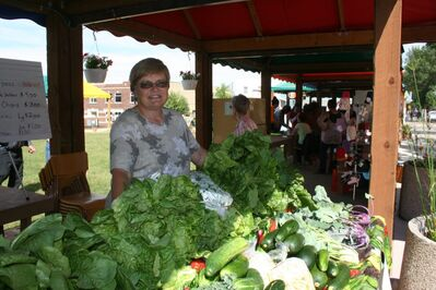 Gemma May of Gemma's Garden sets up shop with her vibrant, fresh produce at Brandon's Global Market.