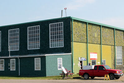 Work to restore the historic hangar at the Commonwealth Air Training Plan Museum has begun. The west side of the hangar has already been repainted in preparation for the September opening of a new memorial dedicated to Second World War pilots.