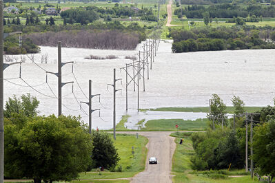 Assiniboine River floodwater covers farmland bordering Grand Valley Road during the July flood. The Assiniboine and Souris rivers are once again at risk of flooding due to recent high amounts of rainfall and more rain in the forecast.