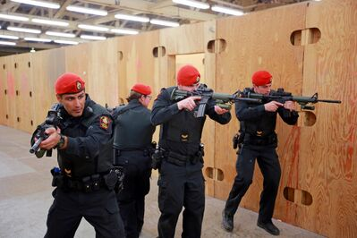 Leading Seaman Derrick Booth, Master Cpl. Jenn Amiro, Cpl. Mitch Fox and Cpl. Casey Charbonneau with 1 Military Police Regiment Shilo Platoon clear rooms as they perform a demonstration for media after a joint exercise between Shilo Military Police, the base's Auxiliary Security Force and Brandon Police Services members at CFB Shilo on Wednesday.