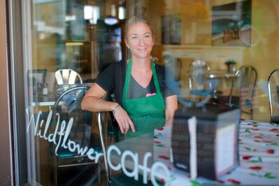 "Kaleigh Stobbe, owner of the Wildflower Café on Rosser Avenue, will be closing the café at the end of the month due to the impending sale of the building. The café is hosting a ""Come Cry with Us"" farewell party featuring live music on May 25, from 4 p.m. to 6 p.m."