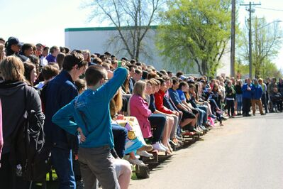 Neelin students watch from the bleachers as their peers show the aftermath of a drunk driving crash during Thursday's demonstration.
