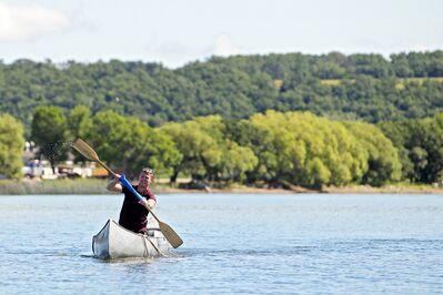 A soldier from CFB Shilo paddles a canoe on Pelican Lake in Ninette on Thursday morning.