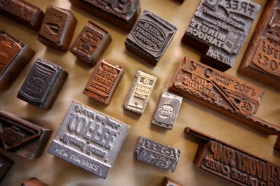 Some of the  collection of historic printing press stamps found by Christina Schlosser in the basement of her restaurant Hansel and Gretel Schnitzel House on First Street.