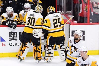 Pittsburgh Penguins goalie Marc-Andre Fleury (29) chats with goalie Matt Murray (30) after being pulled during the first period of game three of the Eastern Conference final in the NHL Stanley Cup hockey playoffs against the Ottawa Senators in Ottawa on May 17, 2017. Pittsburgh Penguins head coach Mike Sullivan would not elaborate much on the decision, but confirmed that Matt Murray would get the start for Game 4 of the Eastern Conference final on Friday night in Ottawa. Murray, who replaced Marc-Andre Fleury in a Game 3 loss to the Senators, will be making his first start since April 6. The Senators have a 2-1 lead in the best-of-seven series. THE CANADIAN PRESS/Sean Kilpatrick