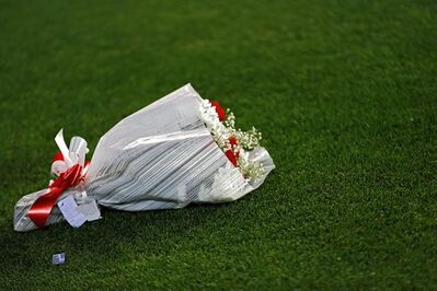 In this photo taken on Wednesday, May 10, 2017, a bunch of red and white carnations rest in a corner of the Vicente Calderon stadium during the Champions League semifinal second leg soccer match between Atletico Madrid and Real Madrid, in Madrid. Atletico Madrid is bidding farewell to its beloved Vicente Calderon. The Spanish league game against Athletic Bilbao on Sunday will be Atletico's last at the old-fashioned venue. The stadium will still host the Copa del Rey final between Barcelona and Alaves on May 27. (AP Photo/Francisco Seco)