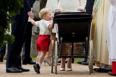 FILE - In this Sunday, July 5, 2015 file photo, Britain's Prince George gets up on tiptoes to peek into the pram of Princess Charlotte flanked by his parents Prince William and Kate the Duchess of Cambridge as they leave after Charlotte's Christening at St. Mary Magdalene Church in Sandringham, England. 33-year-old Pippa Middleton is marrying wealthy financier James Matthews in the village of Englefield, west of London on Saturday May 20, 2017, with a guest list of young A-list royals and reality TV stars looking on. (AP Photo/Matt Dunham, file)