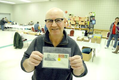 Postal service historian Darcy Hickson is seen with a Vimy Ridge memorial postcard at the Prairie Mountain Philatelic Society's debut event at the Keystone Centre on Saturday.