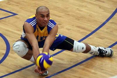 Sam Tuivai of the Brandon University Bobcats plays the ball during a volleyball match against the University of Alberta Golden Bears at the BU Healthy Living Centre on Saturday night.