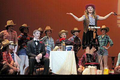 """Members of the cast of École secondaire Neelin High School's major production """"Dirty Rotten Scoundrels"""" perform at the Western Manitoba Centennial Auditorium on May 2."""